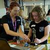 A Questacon Maker Project facilitator assisting a girl with her project
