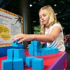 A girl stacking some blocks