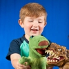 A boy playing with a toy dinosaur