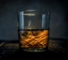 A photograph of a glass of whisky