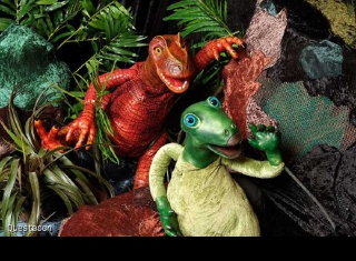 two dinosaur puppets.